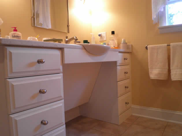 A new handicapped accessible bathroom for a person who uses a wheelchair susan rochelle architect for Wheelchair accessible sink bathroom